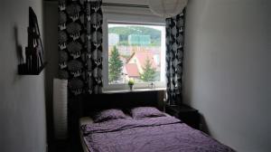 Łóżko lub łóżka w pokoju w obiekcie Apartament 22