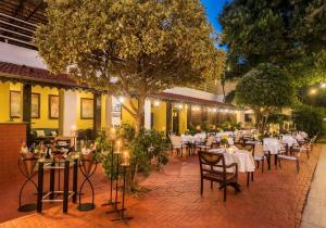 A restaurant or other place to eat at Royal Orchid Metropole