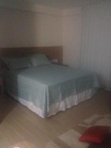 Cama ou camas em um quarto em Flat 320