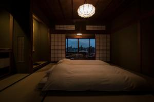 A bed or beds in a room at Yamanoo