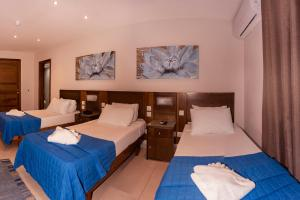A bed or beds in a room at Cerviola Hotel