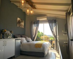 A bed or beds in a room at Studio 13 Durban North
