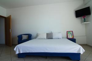 A bed or beds in a room at Apartments Nebeska