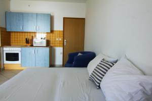 A kitchen or kitchenette at Apartments Nebeska