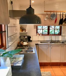 A kitchen or kitchenette at The Goodland Cottages