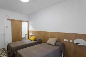 A bed or beds in a room at Hostel.B
