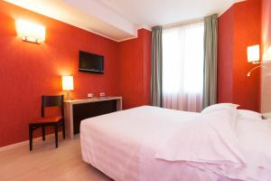 A bed or beds in a room at Best Western Porto Antico