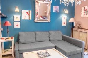 A seating area at Appartement Canourgue - Première Conciergerie