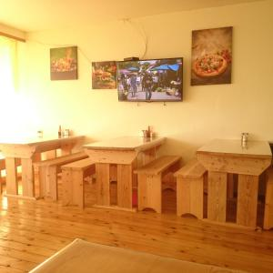 A television and/or entertainment centre at Guesthouse Baykal Lux Aeterna