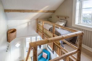 A bunk bed or bunk beds in a room at MINI SAKRISØY Apartment