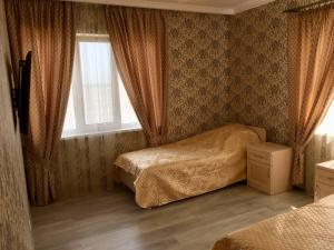 A bed or beds in a room at Holiday Home on Posadochnaya 12