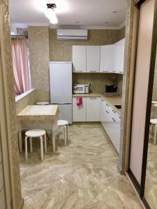 A kitchen or kitchenette at Holiday Home on Posadochnaya 12