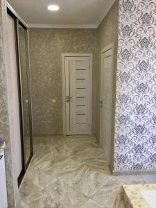 A bathroom at Holiday Home on Posadochnaya 12
