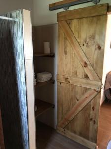 Ein Badezimmer in der Unterkunft El Rancho