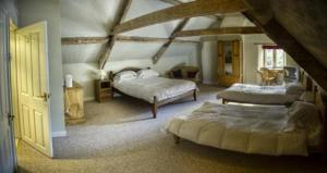 A bed or beds in a room at Neeld Arms