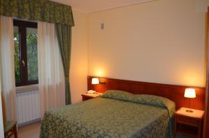 Postel nebo postele na pokoji v ubytování Hotel Olioso