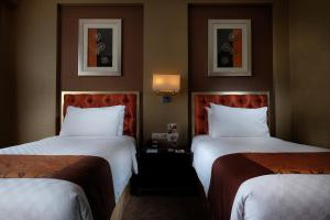 A bed or beds in a room at Hotel Ciputra Semarang