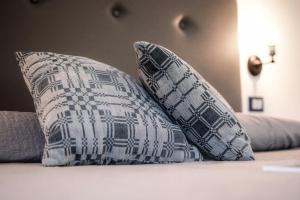 Letto o letti in una camera di Le stanze di Bruno