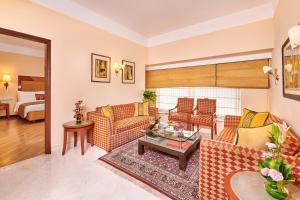A seating area at The Lalit Ashok