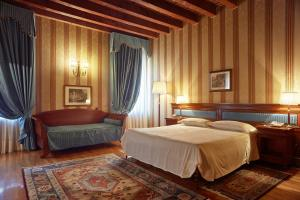 A bed or beds in a room at Villa Quaranta Tommasi Wine Hotel & SPA