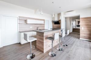 A kitchen or kitchenette at Úttö Luxury Suites