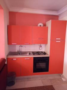 A kitchen or kitchenette at Deluxe Suites Superior Accommodation
