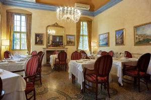 A restaurant or other place to eat at Villa Quaranta Tommasi Wine Hotel & SPA