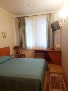 Кровать или кровати в номере Отель Крошка Енот