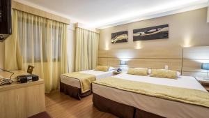 Cama ou camas em um quarto em Faro Hotel Atibaia