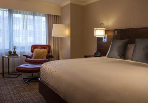 A bed or beds in a room at Renaissance Washington, DC Downtown Hotel
