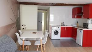 A kitchen or kitchenette at Apartamentos-Bermeo
