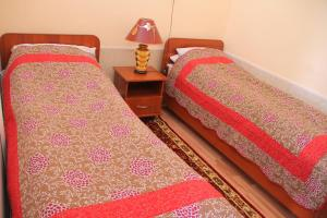 A bed or beds in a room at Biy Ordo Guest House