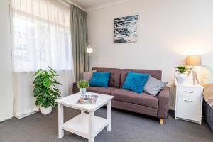 "A seating area at ""Aqua Waves"" Glenelg Central Studios"