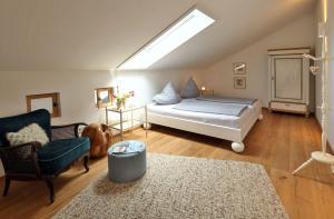 Ein Bett oder Betten in einem Zimmer der Unterkunft Beim Schmied