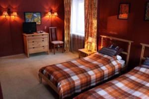 Кровать или кровати в номере Компьютерия Загородный Отель