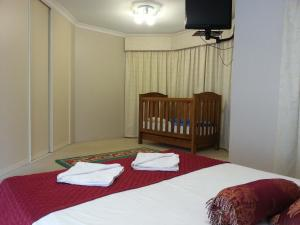 A bed or beds in a room at The Retreat