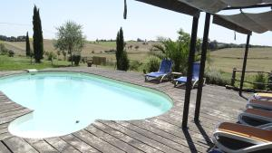 The swimming pool at or near Les Chalets D'Hôtes Esprit Nature