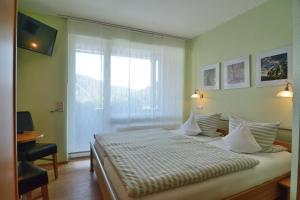 Ein Bett oder Betten in einem Zimmer der Unterkunft Weinhaus Thomas