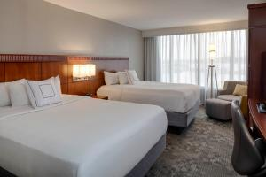 A bed or beds in a room at Courtyard by Marriott Boston Logan Airport