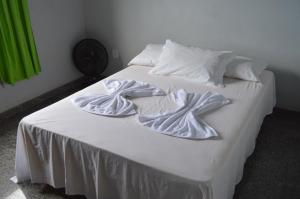 A bed or beds in a room at Vivenda Casagrande