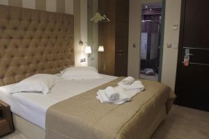 Кровать или кровати в номере Hotel Konaki