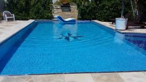 The swimming pool at or near Hospedaria Chez Nous