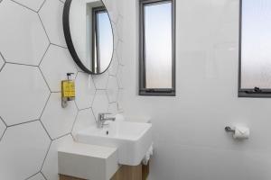 A bathroom at Civic Apartments