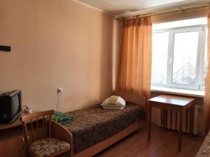 Кровать или кровати в номере Аэроотель