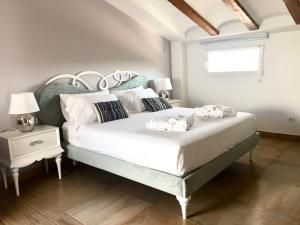 A bed or beds in a room at Casa Boquera