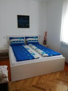 Krevet ili kreveti u jedinici u objektu Apartmani Oletić 4*