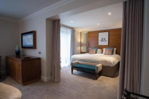A bed or beds in a room at Thorpe Park Hotel and Spa