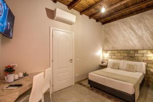 Letto o letti in una camera di Colosseo Accomodation Room Guest House