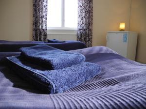 Säng eller sängar i ett rum på Solakoop B&B