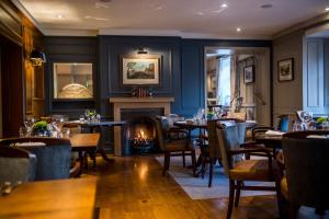 A restaurant or other place to eat at The Millstone, Mellor